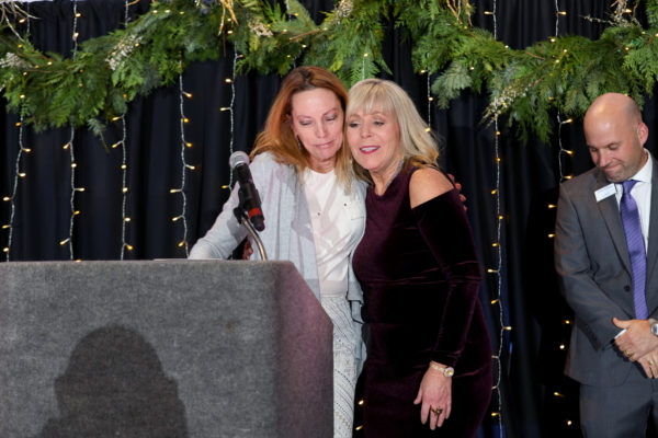 Kathy Herndon congratulates Lori Reece of RE/MAX Whatcom Couny - the Large Business of the Year award recipient.